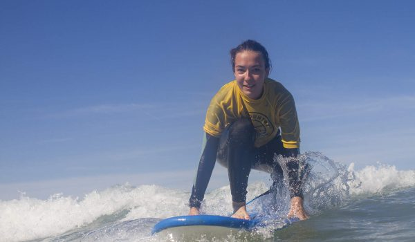 girl kneeling on a surf board