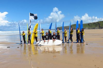 Surfing group on the beach