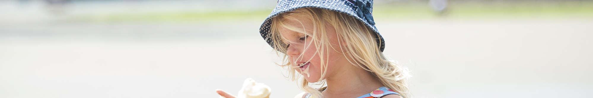little girl enjoying an ice cream