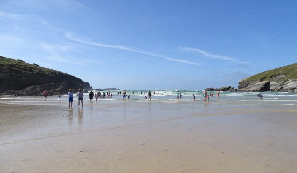 people at Porth beach in summer