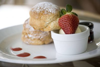 jam, cream and scones on a plate