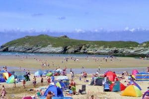 Crowds of people enjoying Porth beach