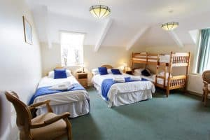 Double bed, single bed and bunk beds in the family room for 5