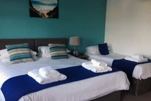 double and single bed in triple beach view room